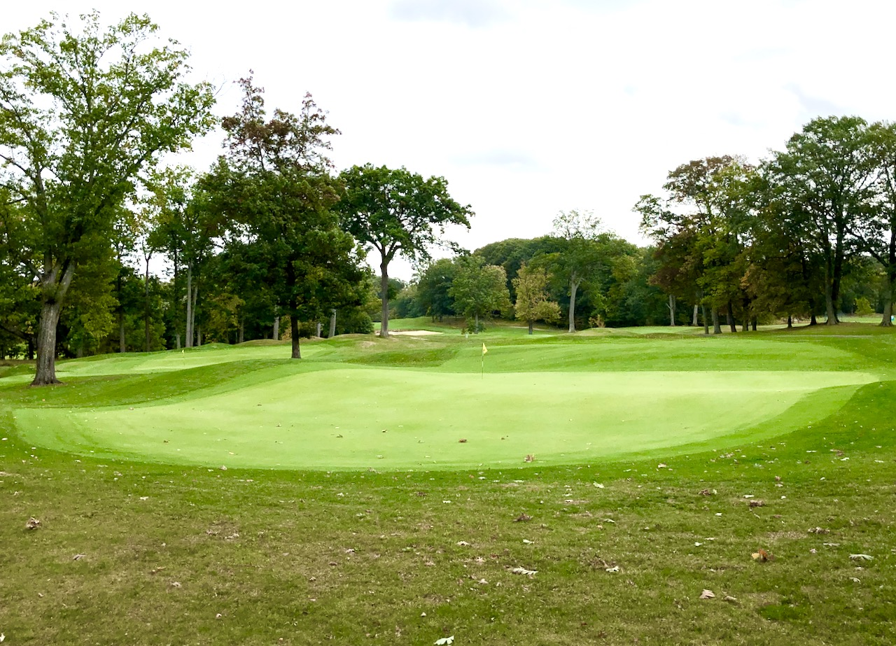 The round at Keney ends with a par three to a blind pin.  You face a two club difference depending on whether the pin is at front or back on the deep green.